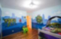Photos of the animino Ninja Turtles Room, a fun and colorful combination of mixed media. Mural artwork, drawings, Vinyl Stckers, Smart Forex colored and painted cutouts.