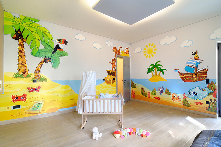Photos of the animino Caribbean Room, a fun and colorful combination of mixed media. Mural artwork, drawings, Smart Forex colored and painted cutouts.