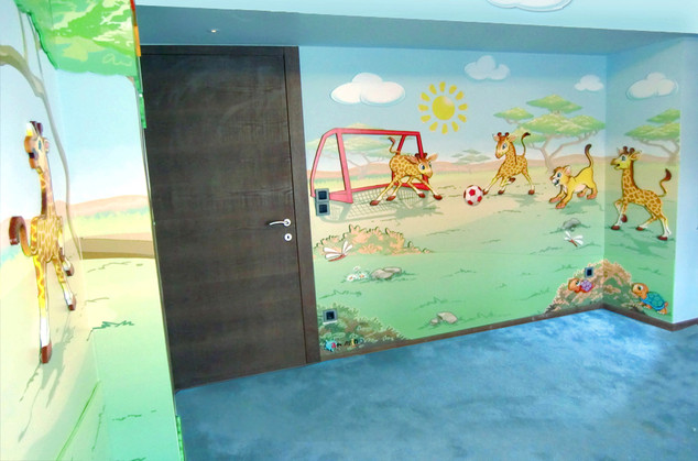 Lion cubs and giraffes Room, a combination of mixed media. Mural artwork, drawings, Vinyl stickers, Smart Forex colored and painted cutouts.