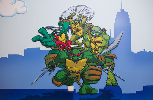 Ninja Turtles Room, a combination of mixed media. Mural artwork, drawings, Vinyl stickers, Smart Forex colored and painted cutouts.