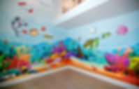 Photos of the animino Coral Reef Room, a fun and colorful combination of mixed media. Mural artwork, drawings, Vinyl Stckers, Smart Forex colored and painted cutouts.