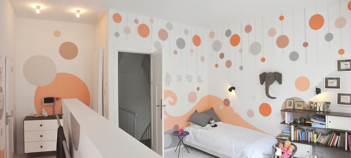 Photos of the animino Bubbles and Waves Room, a fun and colorful combination of mixed media. Mural artwork, drawings, 3D colored and painted cutouts.