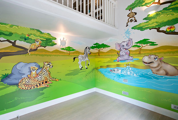 Photos of the animino Savanna Room, a fun and colorful combination of mixed media. Mural artwork, drawings, Vinyl Stckers, Smart Forex colored and painted cutouts.