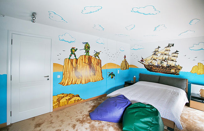 Photos of the animino Pirates and Ninjas Room, a fun and colorful combination of mixed media. Mural artwork, drawings, Vinyl Stckers, Smart Forex colored and painted cutouts.