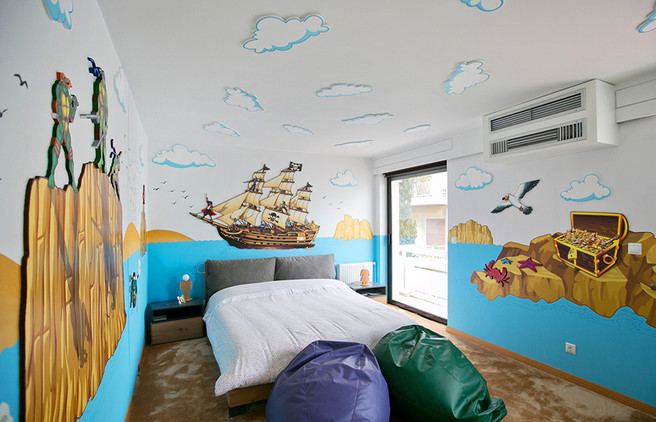 Pirates and Ninjas Room, a combination of mixed media. Mural artwork, drawings, Vinyl stickers, Smart Forex colored and painted cutouts.