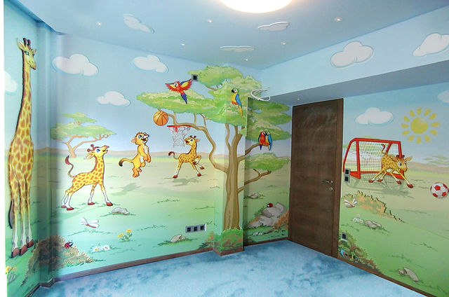 Photos of the animino Lion cubs and Giraffes Room, a fun and colorful combination of mixed media. Mural artwork, drawings, Vinyl Stckers, Smart Forex colored and painted cutouts.