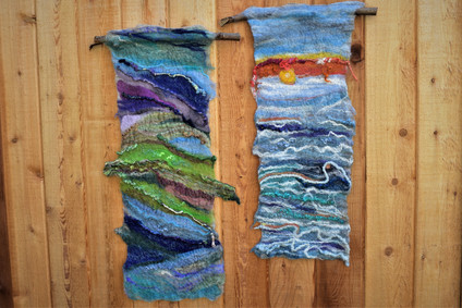 Rolling Hills and Roiling Waters. Felted onto branches. Finished with Hand embroidery. Approx. 1' x 3'
