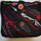 Black bag-large enough for IPad. A pocket on the back outside and one on the inside. Lined with silk.