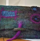 Green & Purple clutch bag with closure.