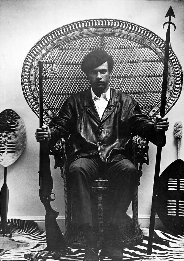 Huey Newton Seated In Wicker Chair, 1967