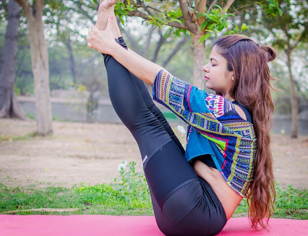 teenage girl practicing yoga