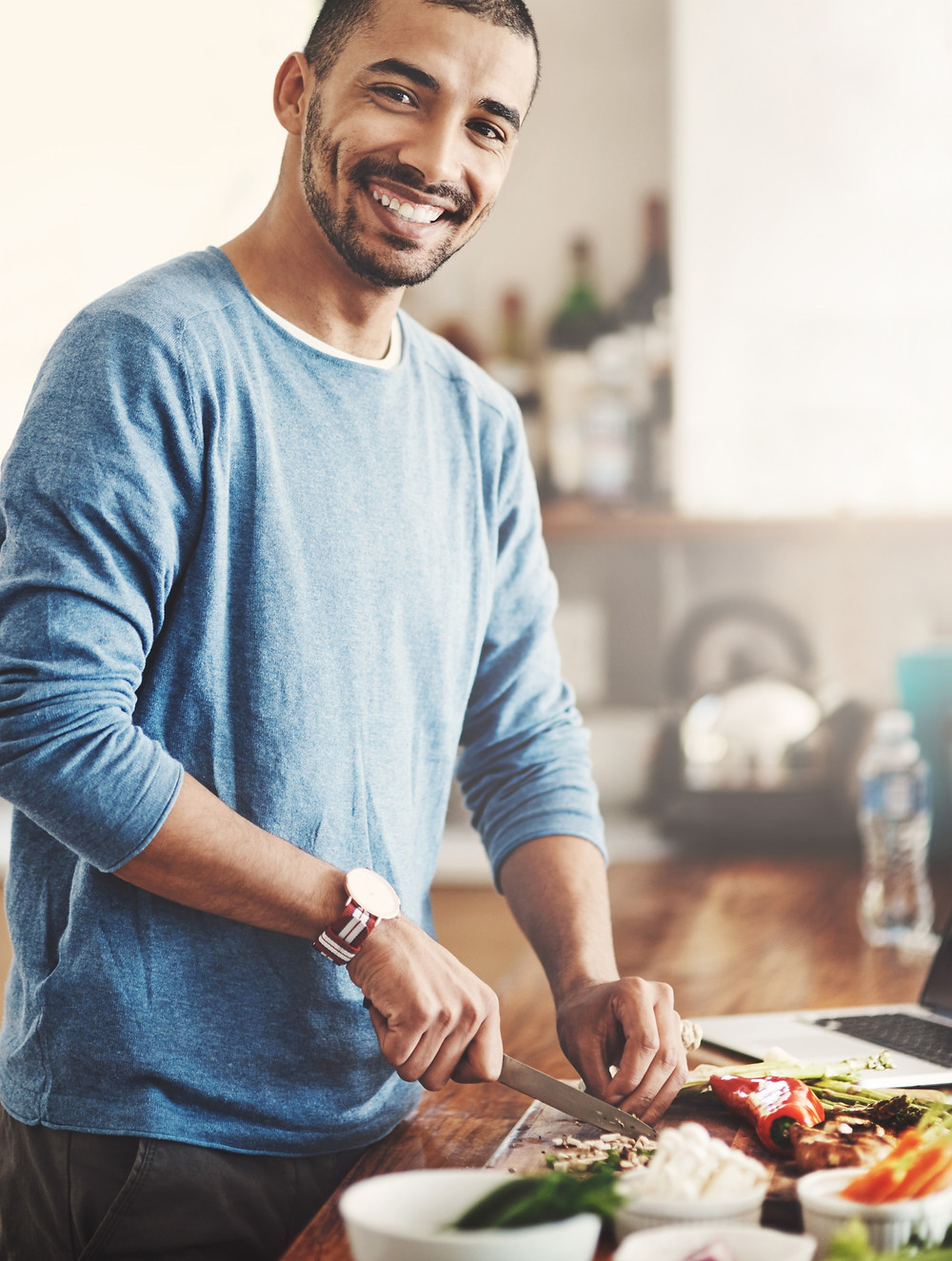 man learning to cook at home