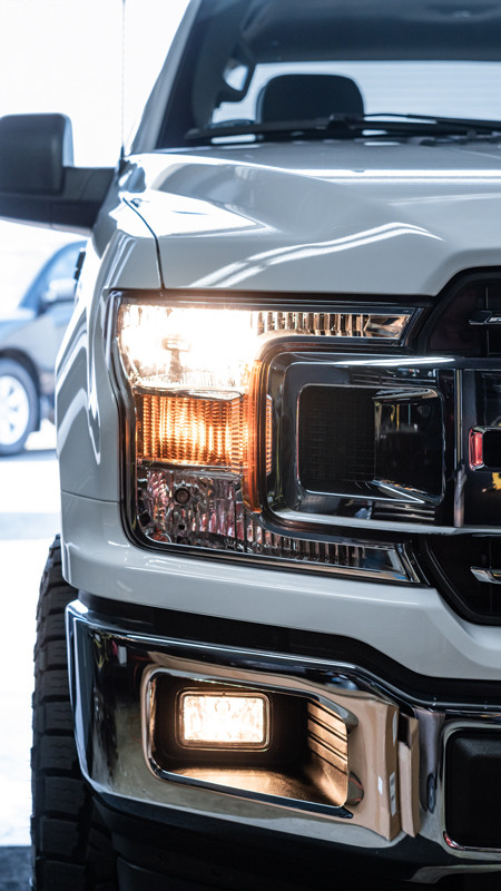 2020 Ford F-150 with OEM halogen headlights and fog lights at MDRN Retrofits
