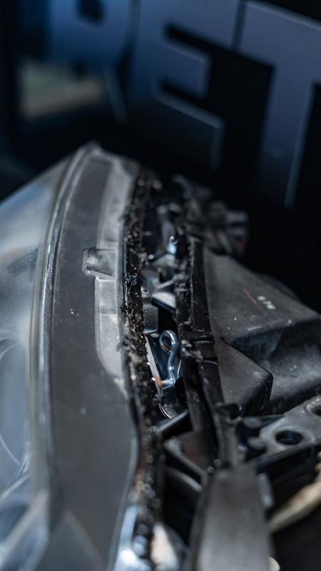Mazda Headlight getting sealed after a headlight retrofit at MDRN retrofits
