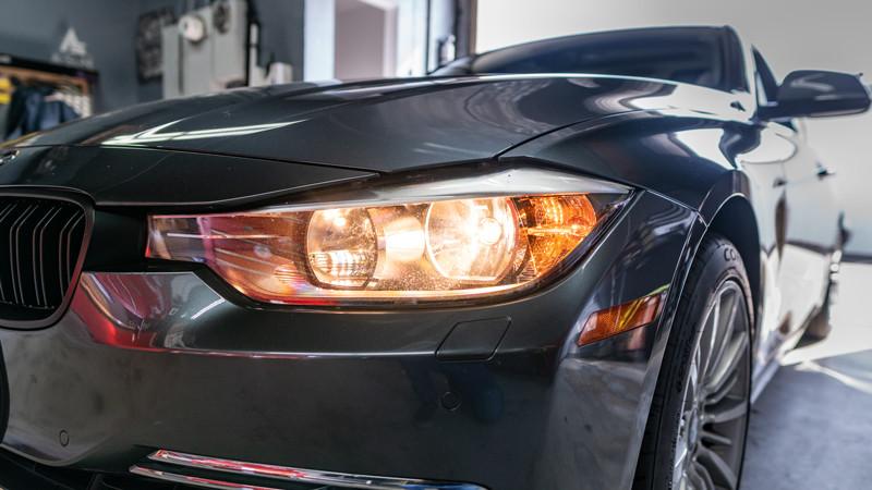 Halogen headlights turned on a 3 Series BMW F30 at mdrn retrofits