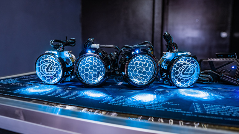 Custom Morimoto D2S and Mini H1 projectors with lens etching and demon eyes at modern retrofits