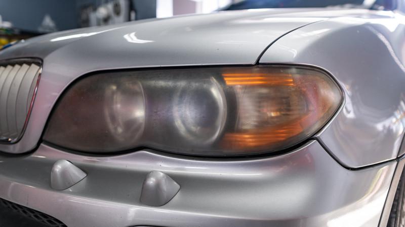 BMW X5 getting headlights restored at modern mdrn retrofits in costa mesa