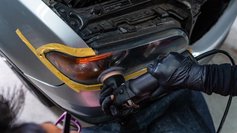 bmw x5 headlights getting polished with rupes polisher at modern mdrn retrofits