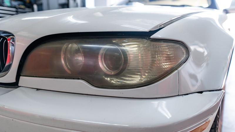 2004 BMW E46 headlights before restoration at mdrn retrofits