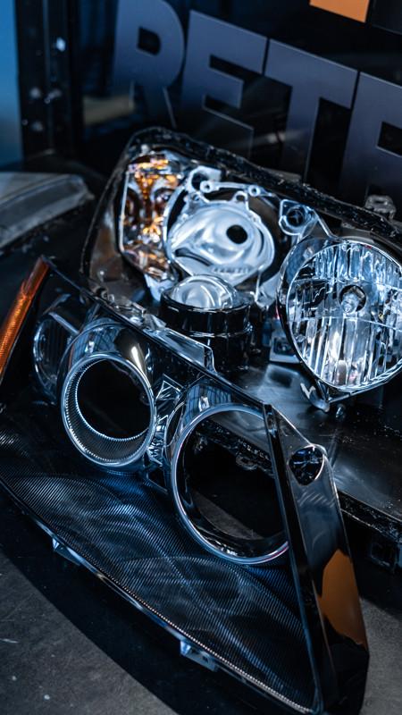 Mazda CX-7 projector headlights taken apart for a headlight retrofit at MDRN retrofits
