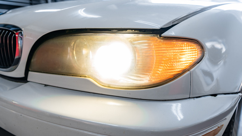 2004 BMW E46 headlights turned on before restoration at mdrn retrofits