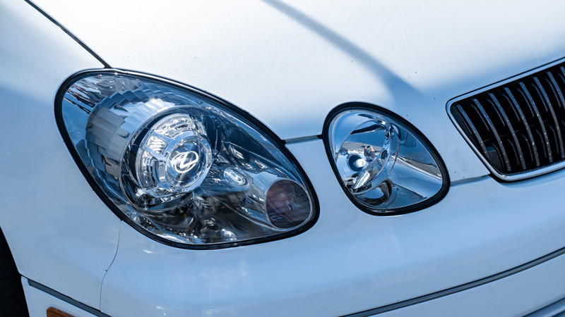 close up of completed pro package headlight retrofit on a 2002 lexus gs300 at MDRN Retrofits