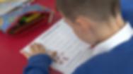 pupil enjoying the Language Magnet activity sheets