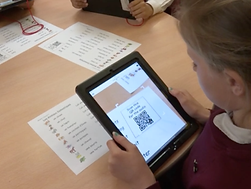 pupils using QR codes to hear the French pronunciation on their activity sheets