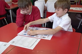 pupils playing a Language Magnet French opinions board game with a support sheet