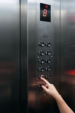 canva-female-hand-pressing-elevator-butt