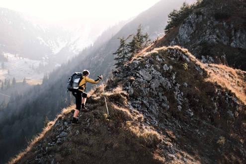 Hiker climbing Brecherspitz in Bavaria, Germany