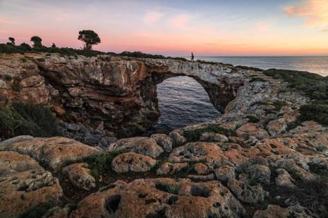 Natural stone bridge at Cala Varques in Mallorca, Spain