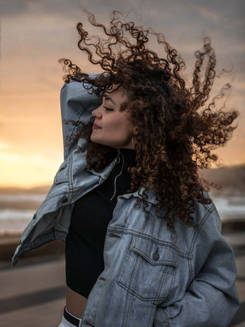 Girl with curly hair in the wind