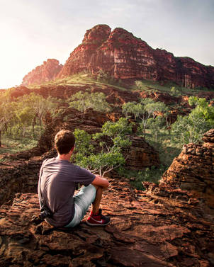Photographer watching sunset in Keep River National Park, Western Australia