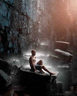 Model shooting under waterfall in Western Australia