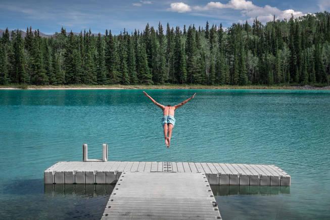 Diving into mountain Lake in Yukon, Canada