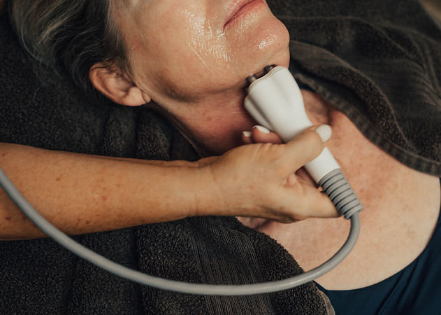 A patient at Azia Medical Spa receiving a Venus Freeze treatment