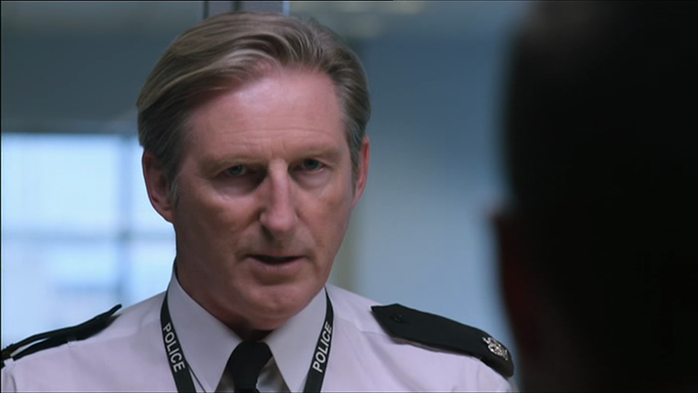 Screen Capture of Superintendent Ted Hastings confronting DSI Carmichael