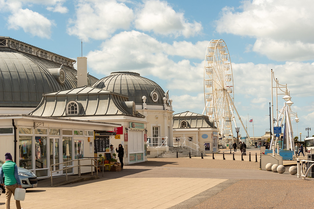 The theatre and ferris wheel on the promenade in Worthing