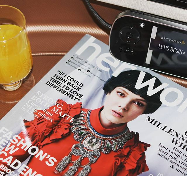 singapore airlines welcome drinks and Her World magazines