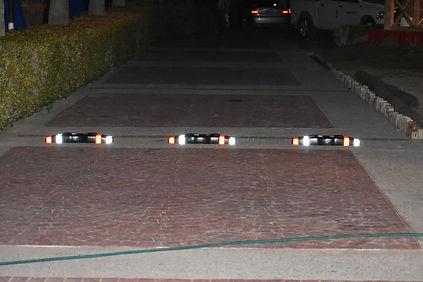 Separator - Black on Brick Sidewalk Nigh