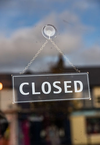 Closed store sign in the window.jpg