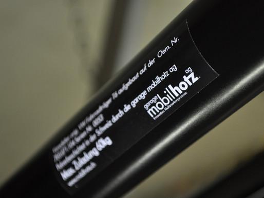 Produktion | Veredelung vom VW T6 original Fahrradträger für die Heckklappe | Pulverbeschichtung in