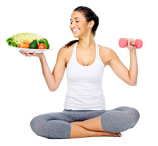 young slender woman holding a plate wih healthy food in one hand and a dumbbel in the other