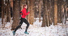 Fitness-woman jogger on snow.jpg