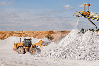 Front end loader and gypsum stock pile.j