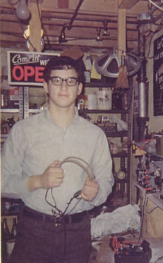 Sixteen year old Mark Gelfand (Nov. 1967) in his tiny electronics workshop. The parts and equipment mostly derived from unrepairable televisions and radios.