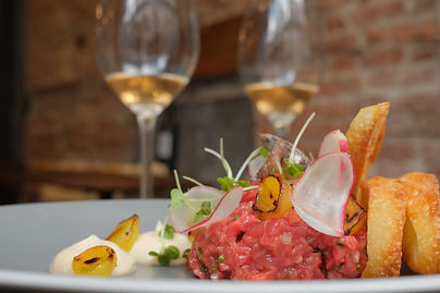 Steak tartare with bacon mayonaaise, pickled onions, radishes, mustard cress, anchovies
