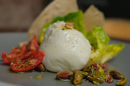 Burrattina salad with dried tomatoes, pistachios, olive tapenade and pane carasau