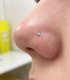 Nose piercing by Sophie